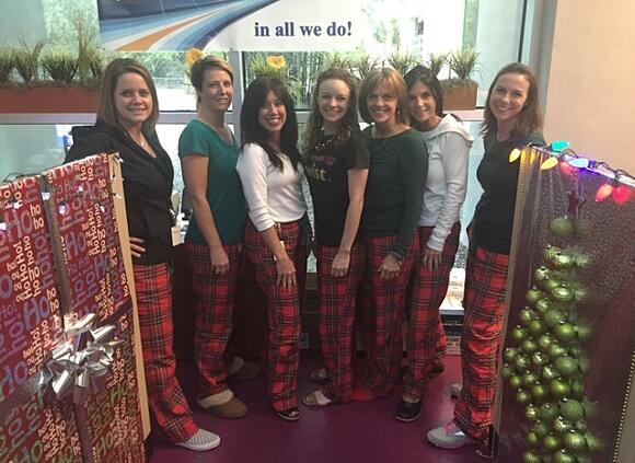 The SpecialEyes team shows their Christmas spirit in matching pajama pants.